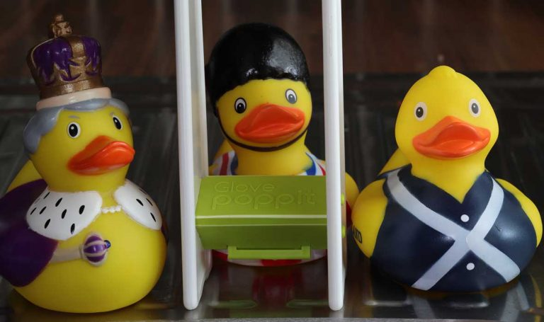 Glove Poppit with rubber ducks by the sink